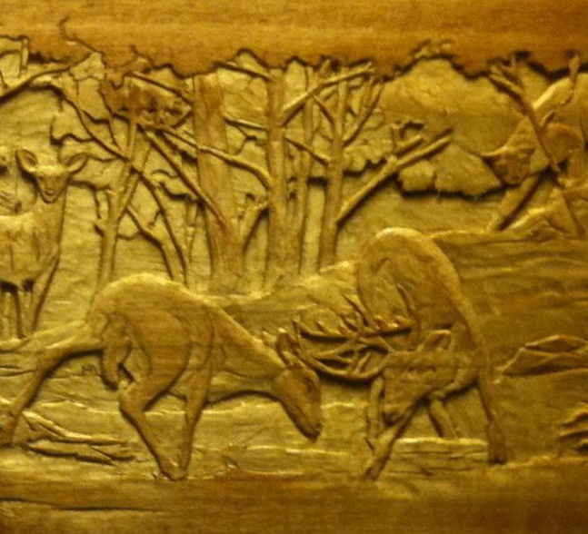 A wood carving cowboy from texas delight in god