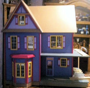 wood carved dollhouse