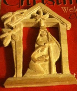 wood carved manger close up